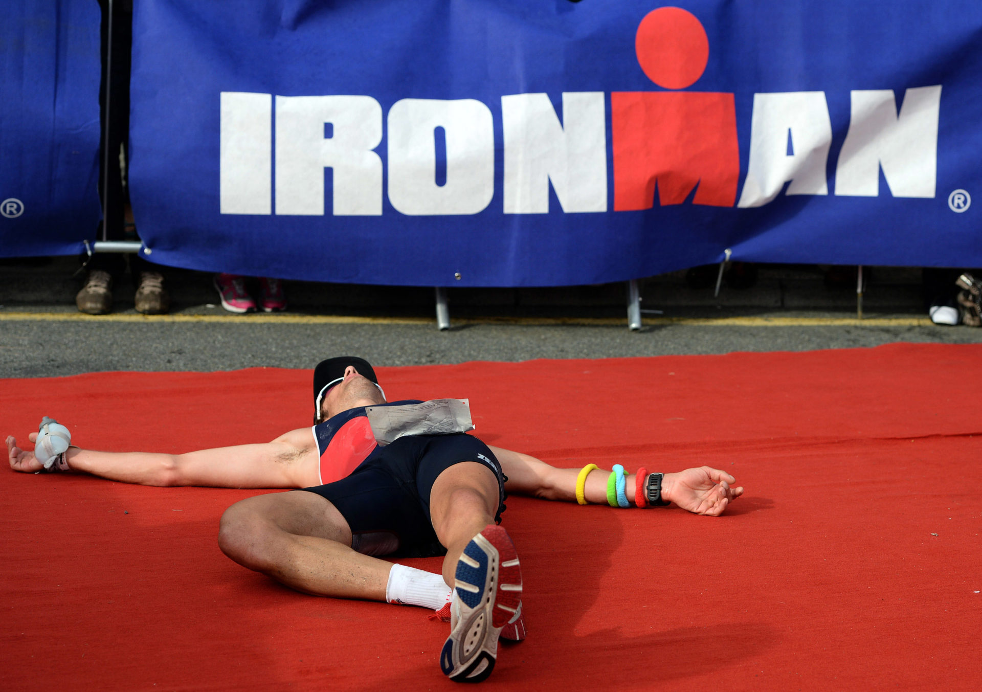 TENBY, WALES - SEPTEMBER 08: Sebastian Escola-Fasseur of France reacts after finishing Ironman Wales triathlon on September 8, 2013 in Tenby, Wales. (Photo by Nigel Roddis/Getty Images)