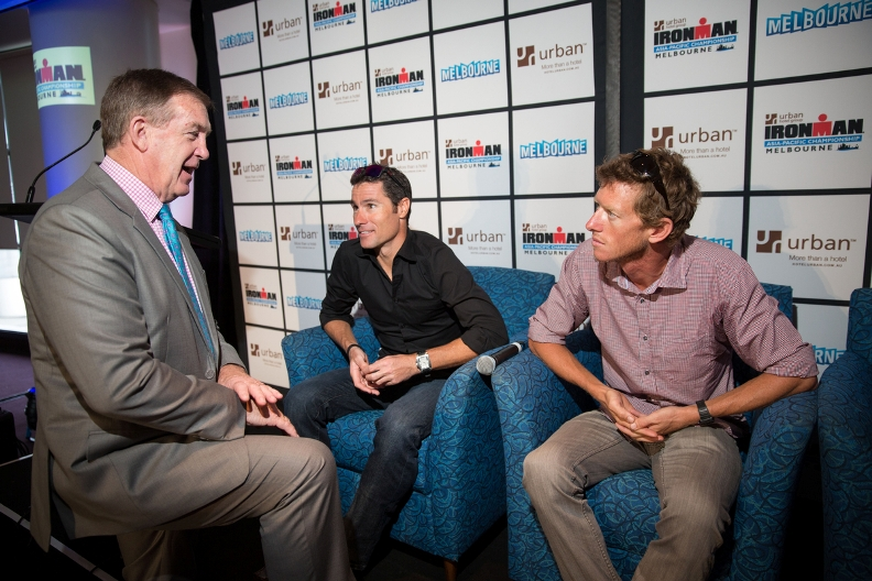Hugh Delahunty MP has a quiet word with IRONMAN Crowwie and Luke. Ironman Melbourne Triathlon Press Launch 2013 - Photo By Lucas Wroe