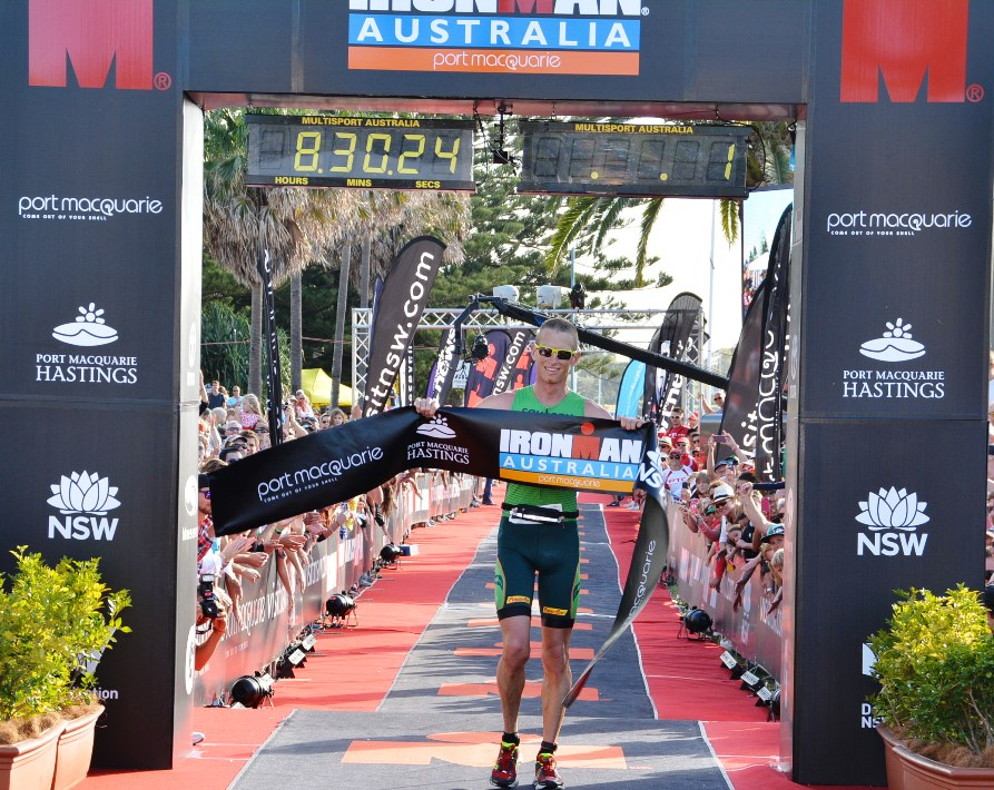 Luke Bell celebrates his maiden Ironman win in Port Macquarie earlier this year