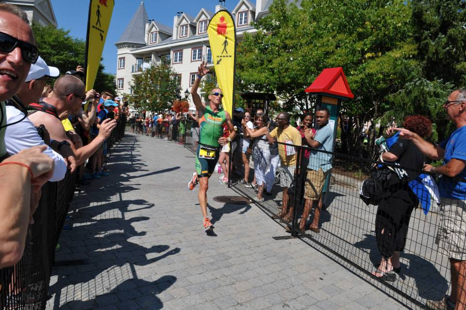 Bell runs through the cobblestone streets of the Mont Tremblant towards the finish line