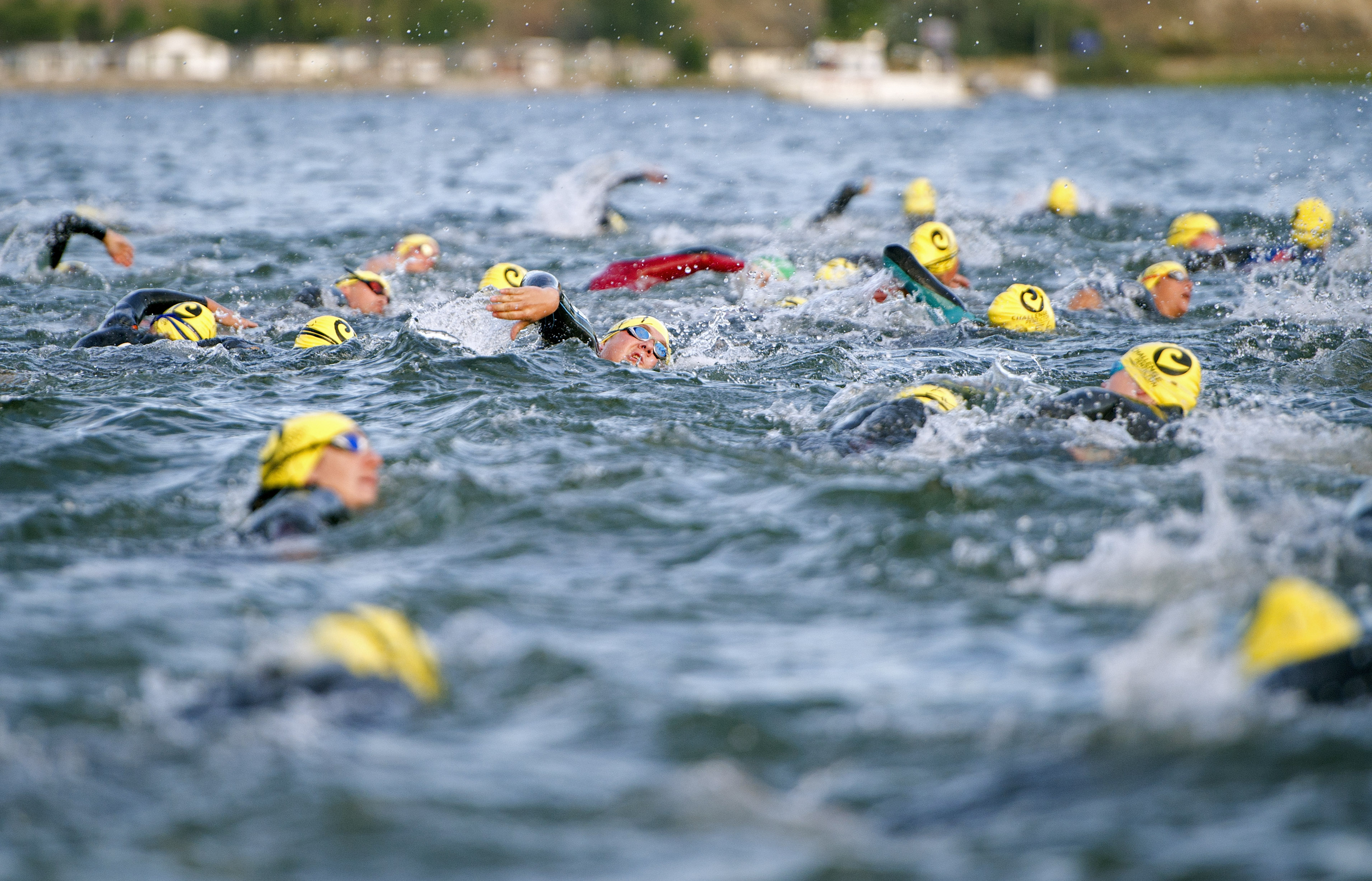 PENTICTON, BRITISH COLUMBIA, CANADA - AUGUST 25: Athletes take to the water the during the Challenge Penticton Triathlon on August 25, 2013 in Penticton, British Columbia, Canada. (Photo by Rich Lam/Getty Images) *** Local Caption ***