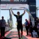 Lionel Sanders crosses the finish line to win the IRONMAN California Oceanside 70.3 on April 2, 2016 in Oceanside, California. (Photo by Donald Miralle for IRONMAN)