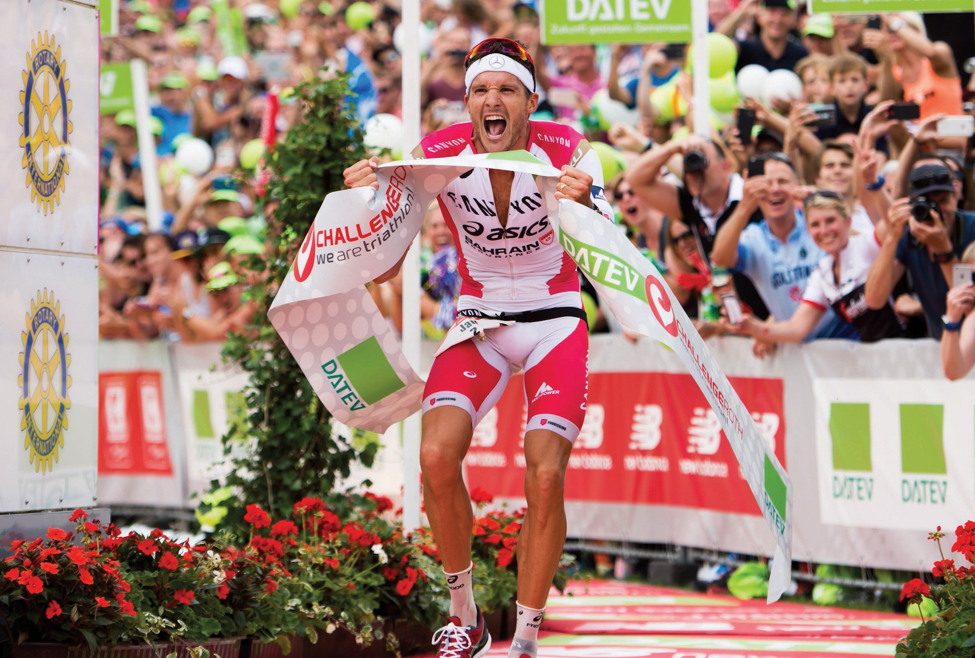 ROTH, GERMANY - JULY 17:  Jan Frodeno of Germany celebrates as he wins Challenge Triathlon Roth and sets a new world record on July 17, 2016 in Roth, Germany.  (Photo by Alex Caparros/Getty Images for Challenge) *** Local Caption *** Jan Frodeno