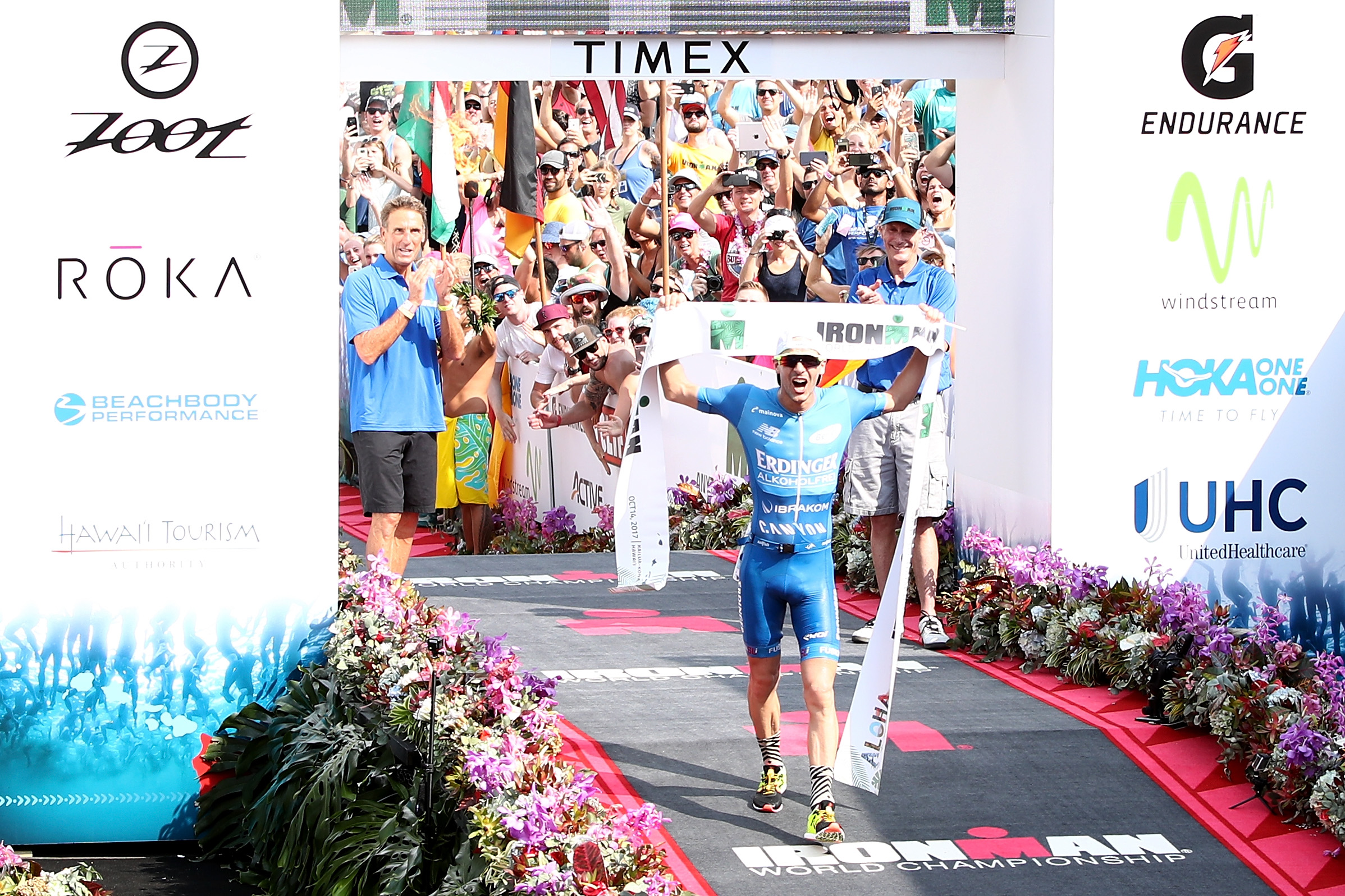KAILUA KONA, HI - OCTOBER 14:  Patrick Lange of Germany celebrates afer winning the IRONMAN World Championship and setting a course record of 8:01.39 beating Craig Alexander's 2011 record of 8:03.56 on October 14, 2017 in Kailua Kona, Hawaii.  (Photo by Maxx Wolfson/Getty Images for IRONMAN)