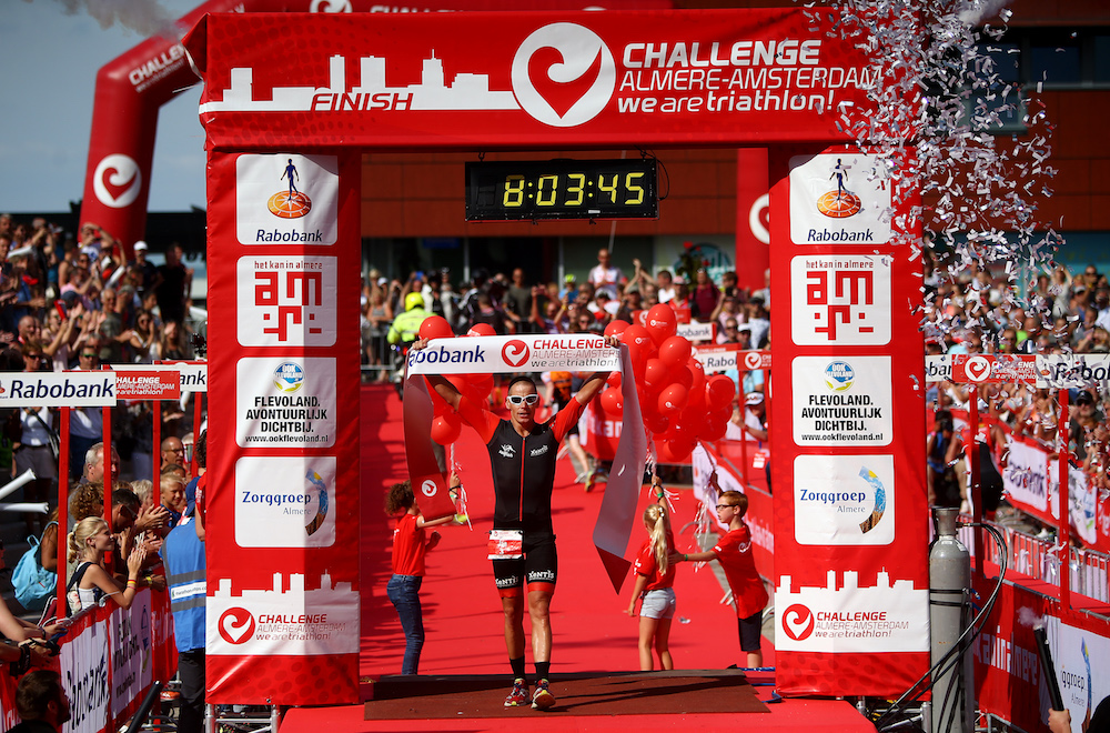 Jan Raphael of Germany celebrates winning the long distance race during Challenge Triathlon Almere-Amsterdam on September 10, 2016 in Almere, Netherlands. (Photo by Charlie Crowhurst/Getty Images for Challenge Triathlon)