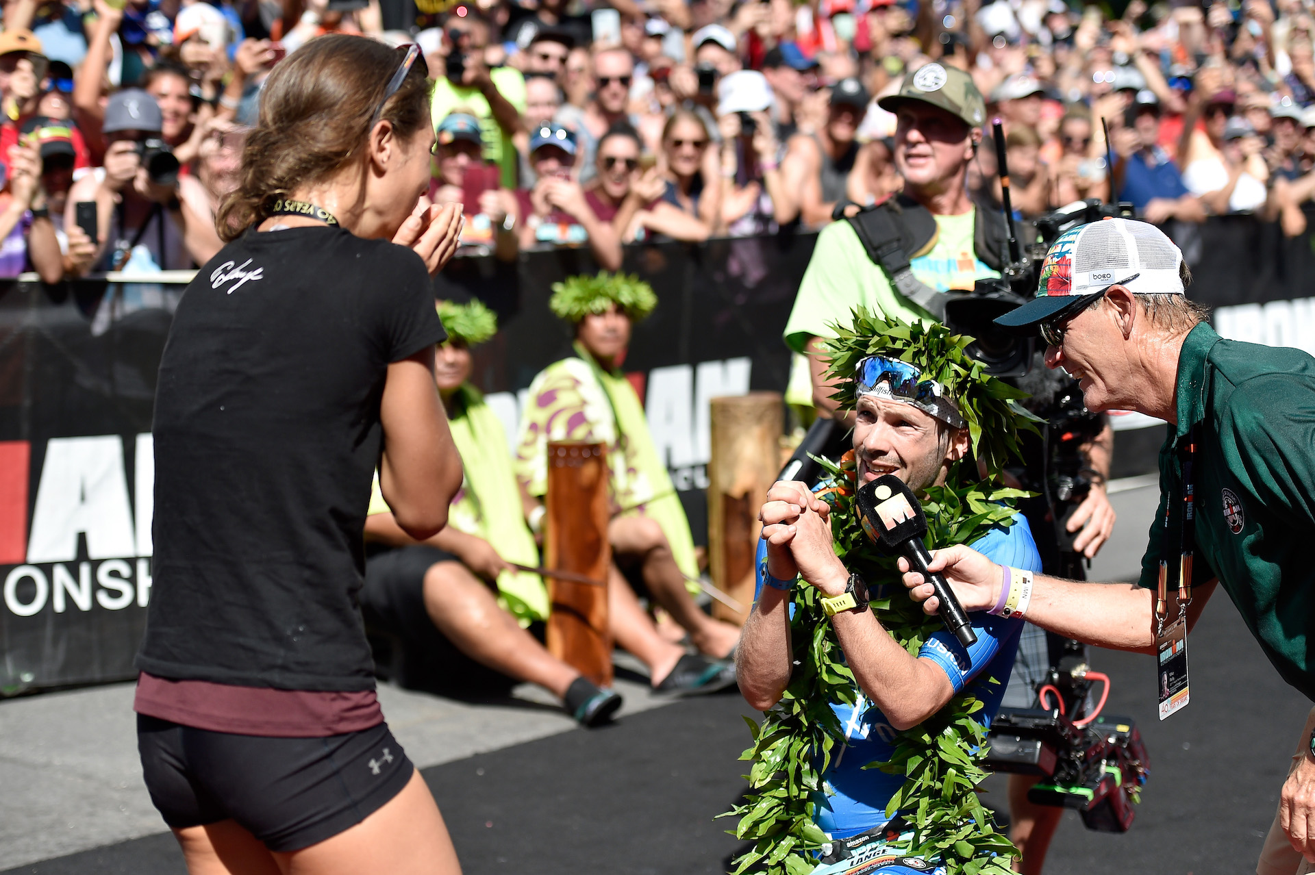 Patrick Lange proposes to his girlfriend Julia Hofmann after Lange sets a course record of 7:52:39 to win the IRONMAN World Championship(Photo by Nils Nilsen/Getty Images for IRONMAN)