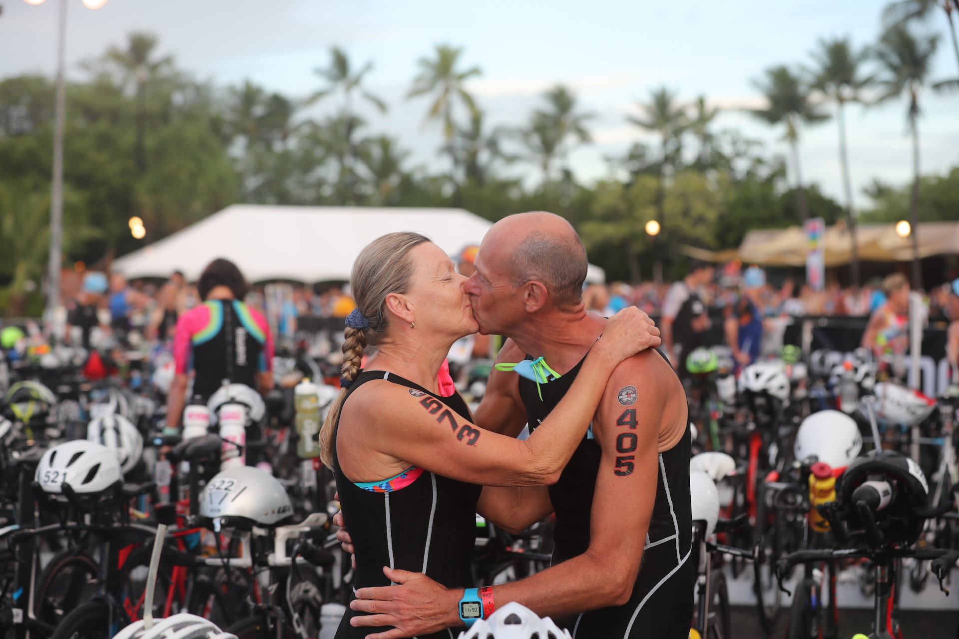 ALOHA IN ACTION: Cordula and Michael Gruber from Munich share a kiss as they set off on their respective journeys at the 2018 IRONMAN World Championship in Kailua-Kona. Both members of Team Gruber were competing in the 55-59 age-group category. The race this year marks the 40th Anniversary of the IRONMAN World Championship (Photo by Tony Svensson/IRONMAN)